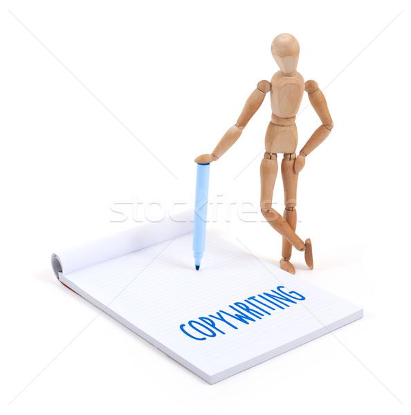 Wooden mannequin writing - Copywriting Stock photo © michaklootwijk