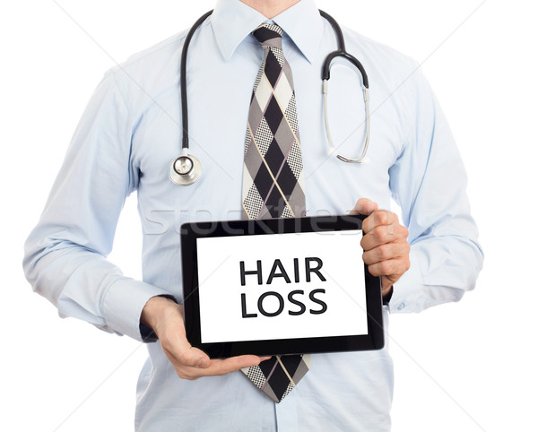 Doctor holding tablet - Hair loss Stock photo © michaklootwijk