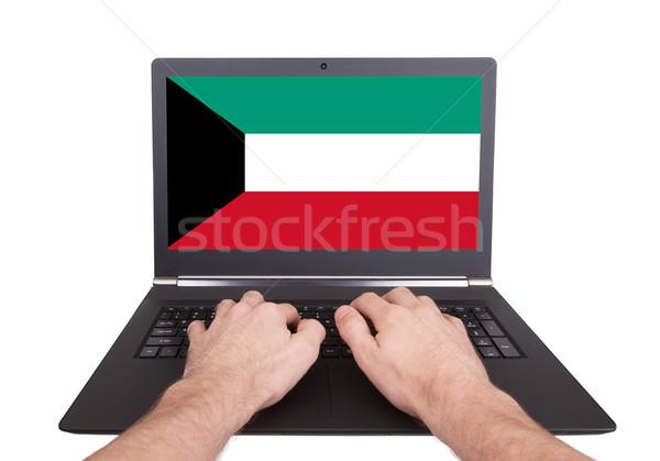 Mani lavoro laptop Kuwait schermo Foto d'archivio © michaklootwijk