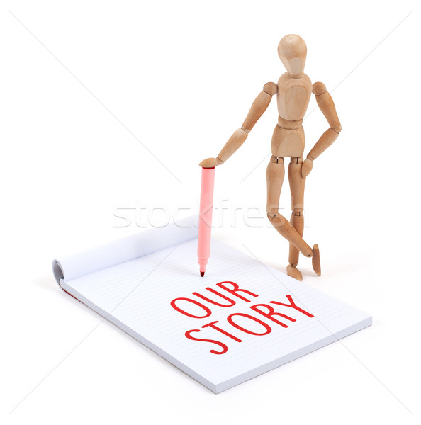 Wooden mannequin writing - our story Stock photo © michaklootwijk