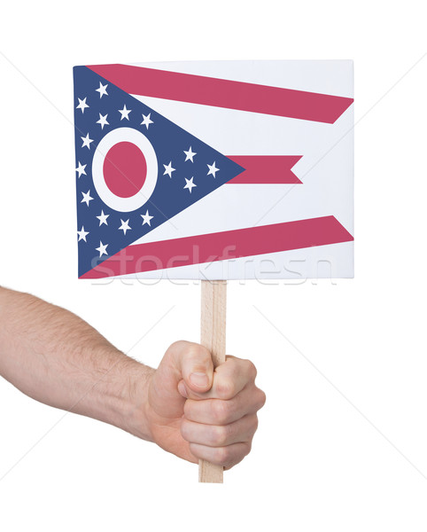 Hand holding small card - Flag of Ohio Stock photo © michaklootwijk
