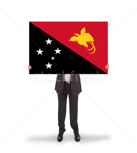 Businessman holding a big card, flag of Papua New Guinea Stock photo © michaklootwijk