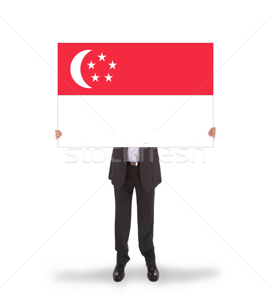 Businessman holding a big card, flag of Singapore Stock photo © michaklootwijk