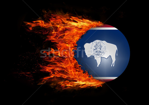 US state flag with a trail of fire - Wyoming Stock photo © michaklootwijk