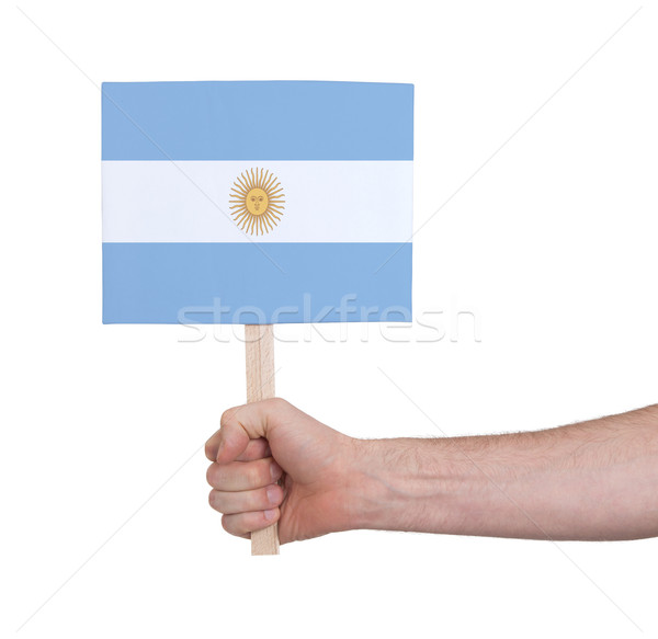 Hand holding small card - Flag of Argentina Stock photo © michaklootwijk