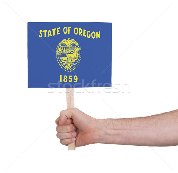 Hand holding small card - Flag of Oregon Stock photo © michaklootwijk