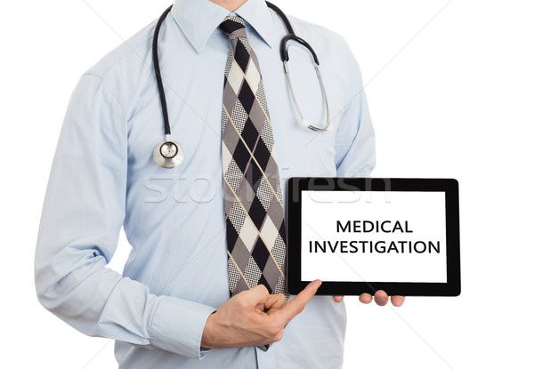 Doctor holding tablet - Medical investigation Stock photo © michaklootwijk