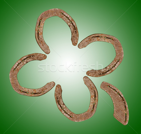 Horseshoes forming a clover leaf Stock photo © michaklootwijk