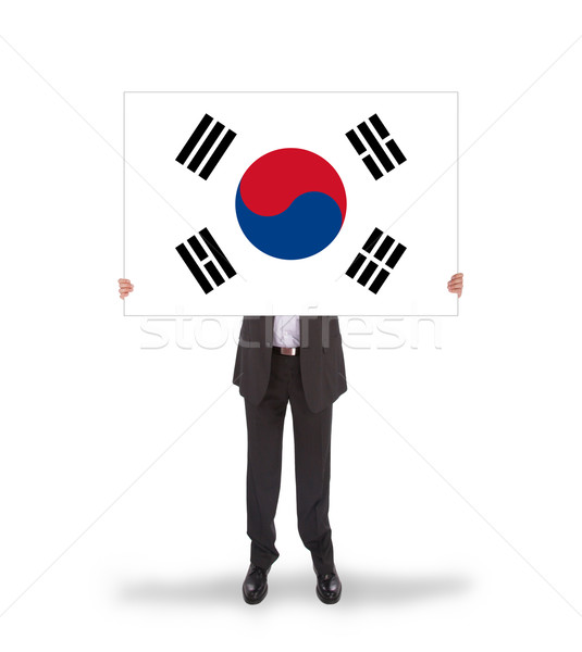 Businessman holding a big card, flag of South Korea Stock photo © michaklootwijk