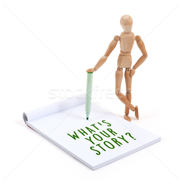 Wooden mannequin writing in scrapbook - What's your story Stock photo © michaklootwijk
