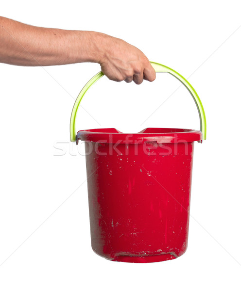 Human hand holding empty plastic pail Stock photo © michaklootwijk