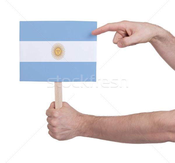 Kéz tart kicsi kártya zászló Argentína Stock fotó © michaklootwijk