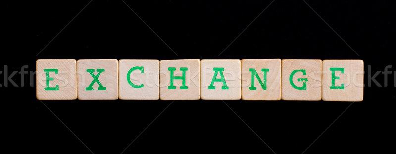 Letters on wooden blocks (exchange) Stock photo © michaklootwijk