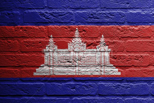 Téglafal festmény zászló Kambodzsa izolált épület Stock fotó © michaklootwijk