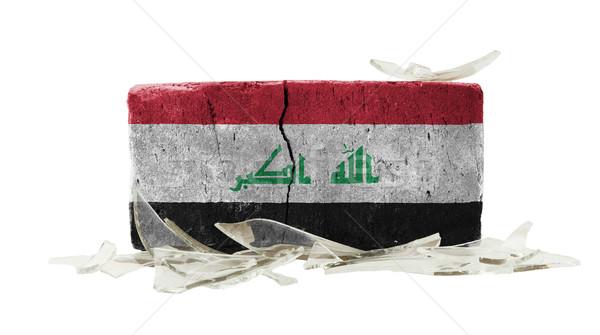 ストックフォト: レンガ · 割れたガラス · 暴力 · フラグ · イラク · 壁