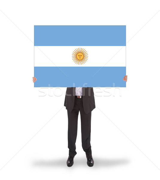 Smiling businessman holding a big card, flag of Argentine Stock photo © michaklootwijk