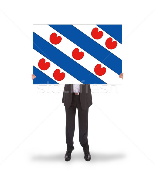 Smiling businessman holding a big card, flag of the dutch provin Stock photo © michaklootwijk