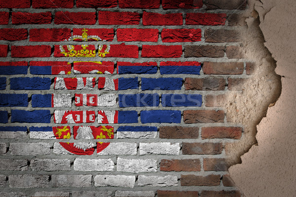Oscuro pared de ladrillo yeso Serbia textura bandera Foto stock © michaklootwijk