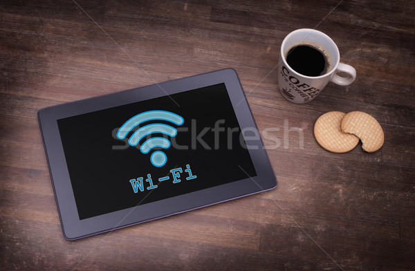 Tabletta wifi kapcsolat fából készült asztal számítógép Stock fotó © michaklootwijk