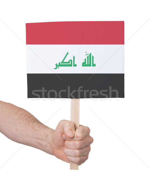 Hand holding small card - Flag of Iraq Stock photo © michaklootwijk