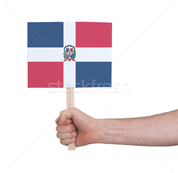 Hand holding small card - Flag of Dominican Republic Stock photo © michaklootwijk