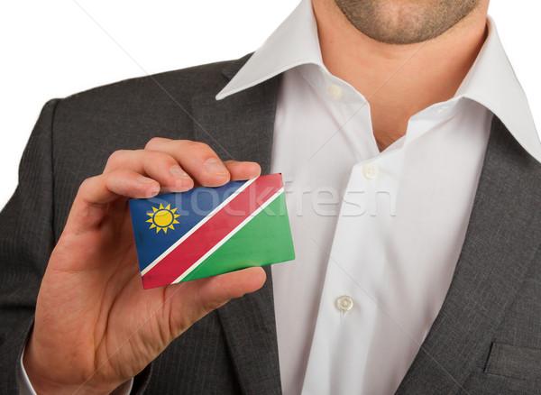 üzletember tart névjegy Namíbia zászló munkás Stock fotó © michaklootwijk