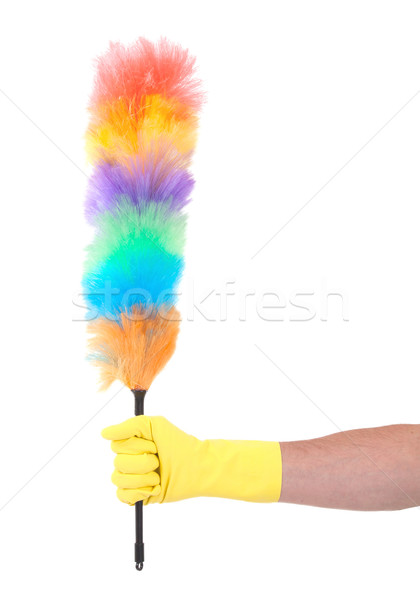 Man with yellow cleaning glove holding a duster Stock photo © michaklootwijk