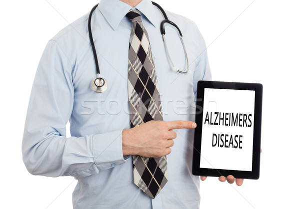Doctor holding tablet - Alzheimers disease Stock photo © michaklootwijk