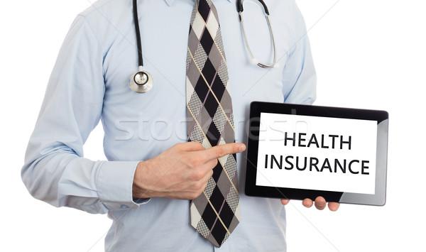 Doctor holding tablet - Health insurance Stock photo © michaklootwijk