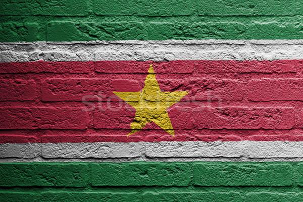 кирпичная стена Живопись флаг Суринам изолированный краской Сток-фото © michaklootwijk
