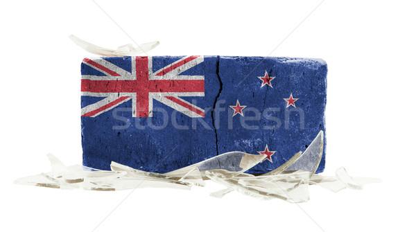 Baksteen gebroken glas geweld vlag New Zealand muur Stockfoto © michaklootwijk