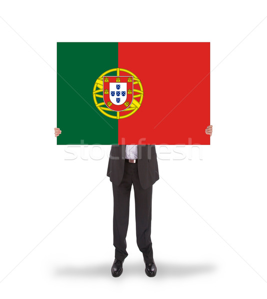 Smiling businessman holding a big card, flag of Portugal Stock photo © michaklootwijk