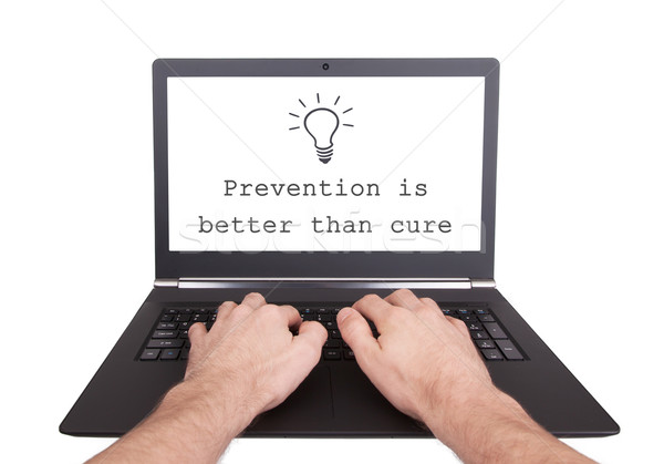 Man working on laptop, preventions is better than cure Stock photo © michaklootwijk