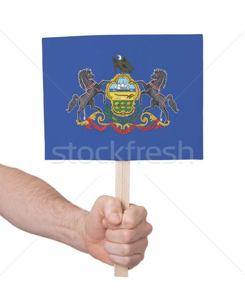 Kéz tart kicsi kártya zászló Pennsylvania Stock fotó © michaklootwijk