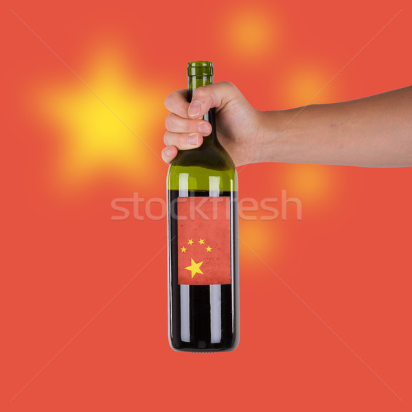 Mano botella vino tinto etiqueta China Foto stock © michaklootwijk