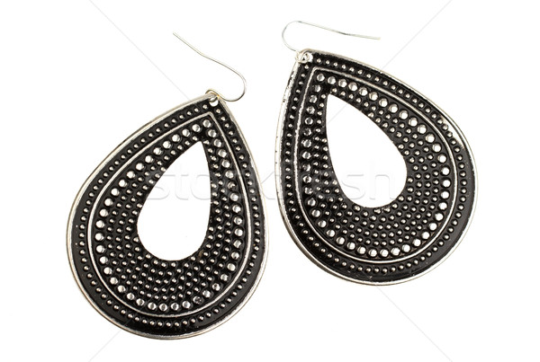 Used large black earrings on a white background Stock photo © michaklootwijk