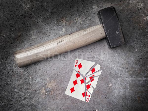 Hammer with a broken card, nine of diamonds Stock photo © michaklootwijk
