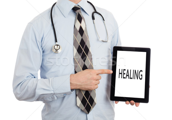 Doctor holding tablet - Healing Stock photo © michaklootwijk