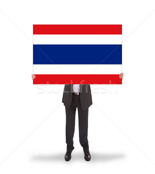 Businessman holding a big card, flag of Thailand Stock photo © michaklootwijk