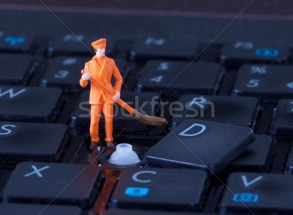 Miniature worker with broom working on keyboard Stock photo © michaklootwijk