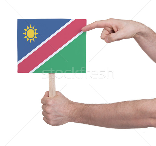 Hand holding small card - Flag of Namibia Stock photo © michaklootwijk