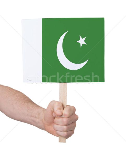 Kéz tart kicsi kártya zászló Pakisztán Stock fotó © michaklootwijk