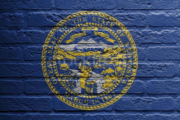 Téglafal festmény zászló Nebraska izolált épület Stock fotó © michaklootwijk