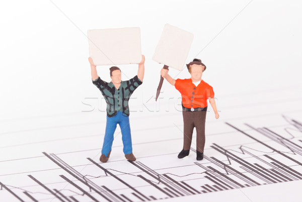 Tiny person demonstrating on a graph Stock photo © michaklootwijk
