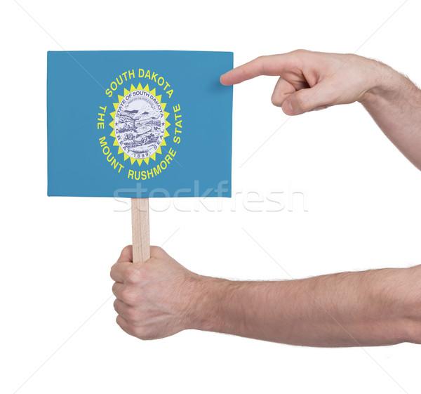 Kéz tart kicsi kártya zászló Dél-Dakota Stock fotó © michaklootwijk