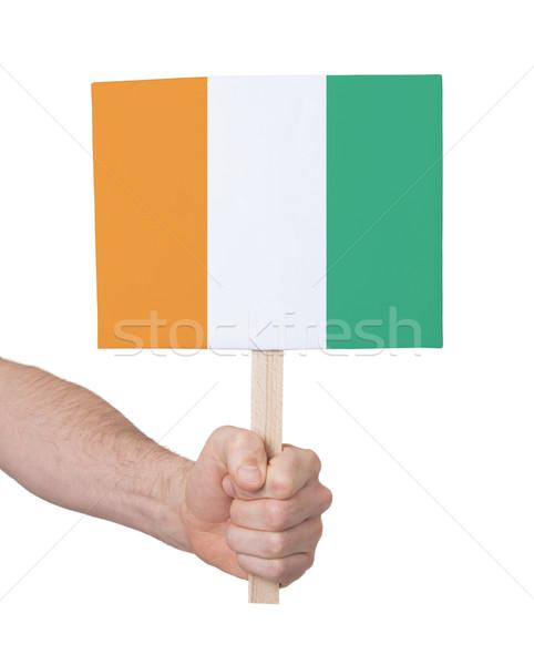 Kéz tart kicsi kártya zászló Elefántcsontpart Stock fotó © michaklootwijk