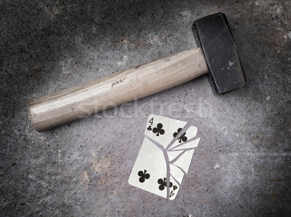Hammer with a broken card, four of clubs Stock photo © michaklootwijk