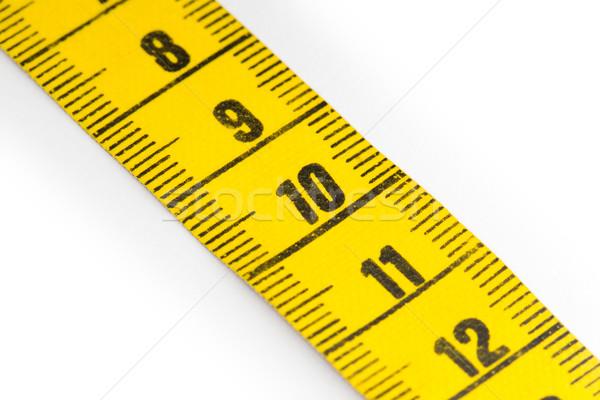 Amarillo cinta métrica aislado atención selectiva blanco medición Foto stock © michaklootwijk
