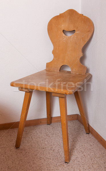 Old wooden chair at the room corner of old house, Switzerland Stock photo © michaklootwijk