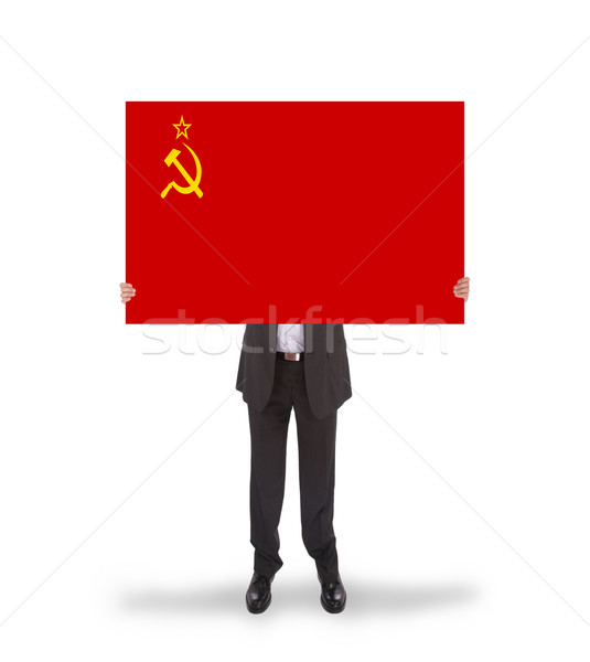 Smiling businessman holding a big card, flag of the USSR Stock photo © michaklootwijk